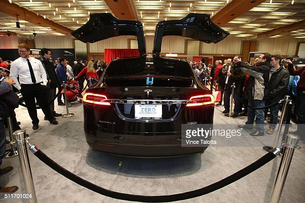 TORONTO ON FEBRUARY 13 Tstar 2016 auto show Auto Show goers take pictures Tesla Model X at the 2016 Canadian International Auto Show held at the...