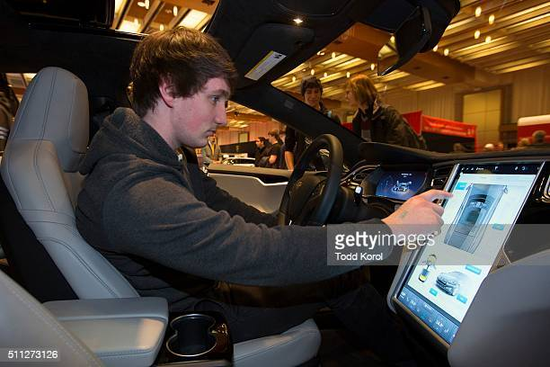 Tstar 2016 auto show Hugo Hamilton check out the interactive screen in a Tesla at the Canadian International Autoshow in Toronto Ontario