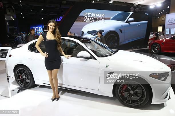 TORONTO ON FEBRUARY 16 Tstar 2016 auto show Model poses with Alfa Romeo Giulia Quadrifoglio at the 2016 Canadian International Auto Show held at the...