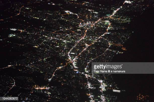 Tsu city in Mie prefecture in Japan night time aerial view from airplane