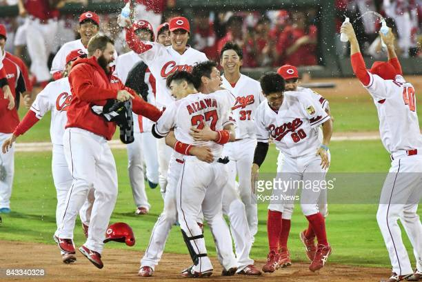 Tsubasa Aizawa celebrates after hitting a walkoff single in the 11th inning to give the Hiroshima Carp a 43 win over the Hanshin Tigers at Mazda...