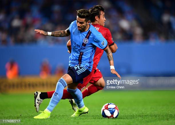 Tsubasa Endoh of Toronto FC and Ronald Alberto Matarrita Ulateat of New York City FC fight for the ball at Yankee Stadium on September 11 2019 in the...