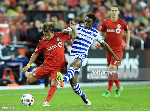 Tsubasa Endoh of Toronto FC battles for the ball with Fabian Castillo of FC Dallas during the second half of an MLS soccer game at BMO Field on May 7...