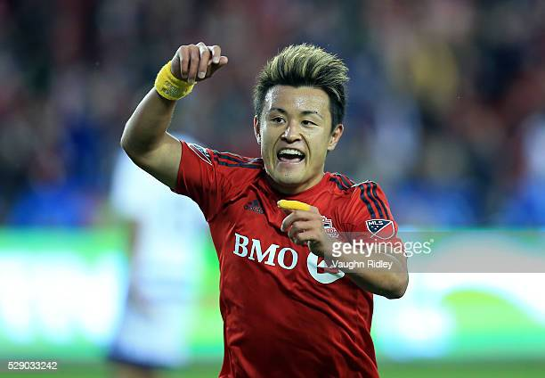 Tsubasa Endoh of Toronto FC celebrates a goal during the first half of an MLS soccer game against FC Dallas at BMO Field on May 7 2016 in Toronto...