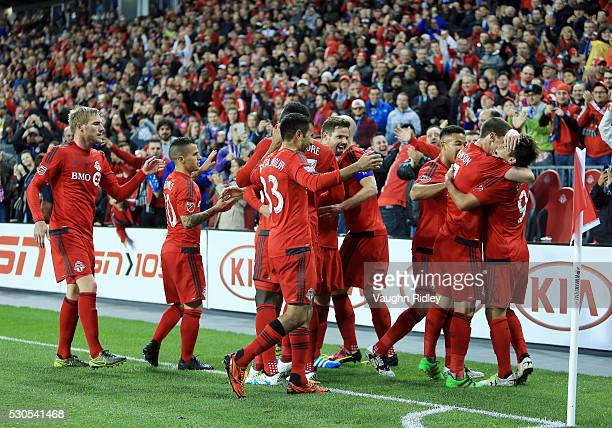 Tsubasa Endoh of Toronto FC celebrates a goal with teammates during the first half of an MLS soccer game against FC Dallas at BMO Field on May 7 2016...