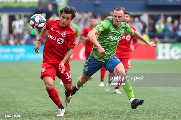 Tsubasa Endoh of Toronto FC chases the ball against Brad Smith of the Seattle Sounders in the first half during the 2019 MLS Cup at CenturyLink Field...