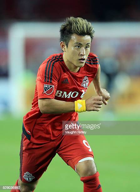 Tsubasa Endoh of Toronto FC chases the ball during the second half of an MLS soccer game against FC Dallas at BMO Field on May 7 2016 in Toronto...