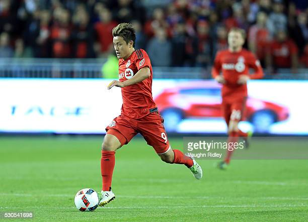 Tsubasa Endoh of Toronto FC dribbles the ball during the first half of an MLS soccer game against FC Dallas at BMO Field on May 7 2016 in Toronto...