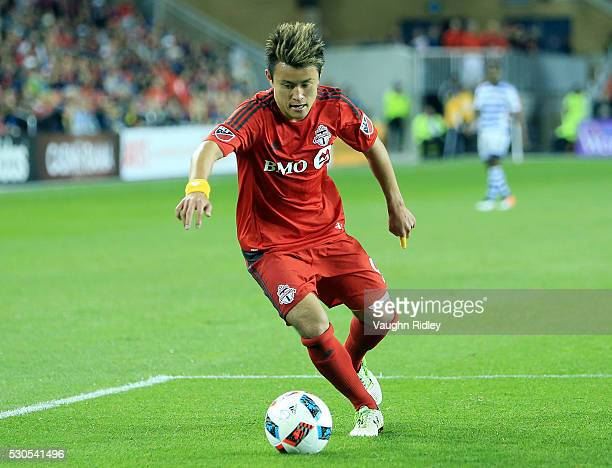 Tsubasa Endoh of Toronto FC dribbles the ball during the second half of an MLS soccer game against FC Dallas at BMO Field on May 7 2016 in Toronto...