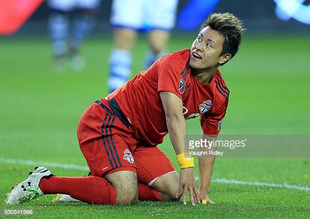 Tsubasa Endoh of Toronto FC gets up after being knocked down during the first half of an MLS soccer game against FC Dallas at BMO Field on May 7 2016...