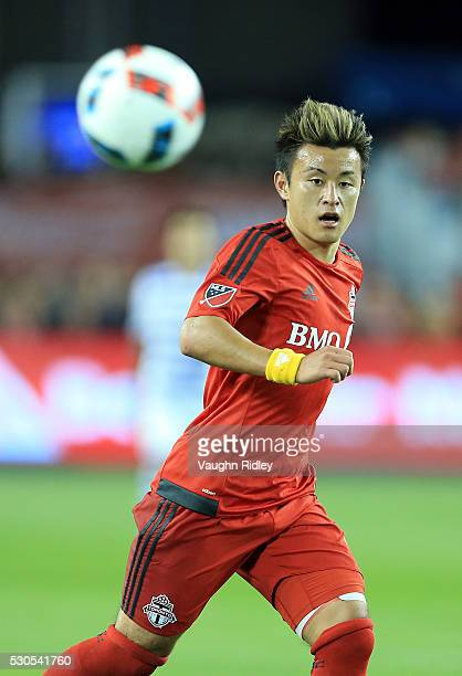 Tsubasa Endoh of Toronto FC passes the ball during the second half of an MLS soccer game against FC Dallas at BMO Field on May 7 2016 in Toronto...