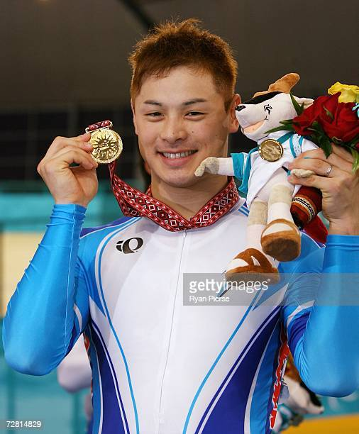 Tsubasa Kitatsuru of Japan poses with his gold medal after winning in the Men's Sprint Finals at the 15th Asian Games Doha 2006 at the Aspire Hall on...
