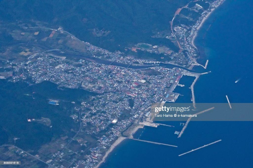 Tsugaru Strait and Mutsu city in Aomori prefecture in Japan daytime aerial view from airplane : Stock-Foto