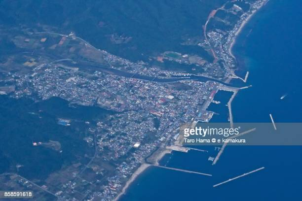 Tsugaru Strait and Mutsu city in Aomori prefecture in Japan daytime aerial view from airplane