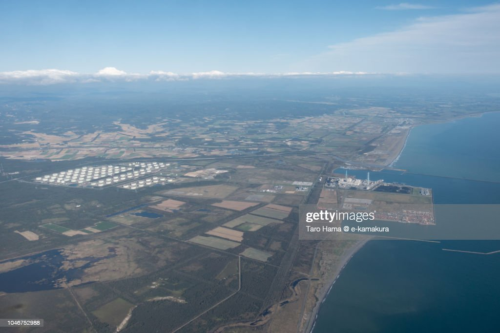 Tsugaru Strait, and Tomakomai city and Atsuma town in Hokkaido daytime aerial view from airplane : ストックフォト