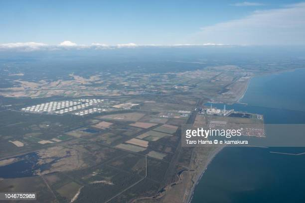 Tsugaru Strait, and Tomakomai city and Atsuma town in Hokkaido daytime aerial view from airplane