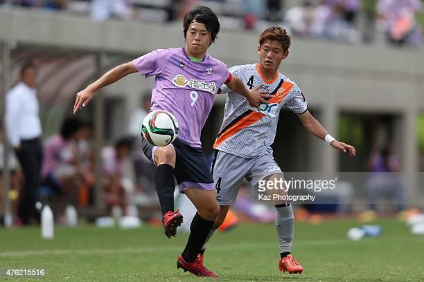 Tsugutoshi Oishi of Fujieda MYFC and Ryuta Koike of Renofa Yamaguchi compete for the ball during the JLeague third division match between Fujieda...