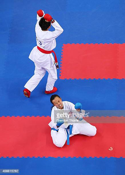Tsui Ping Ku of Chinese Taipei celebrates victory as Yee Ting Tsang of Hong Kong shows her dejection following the Women's 50kg Semi Final during day...