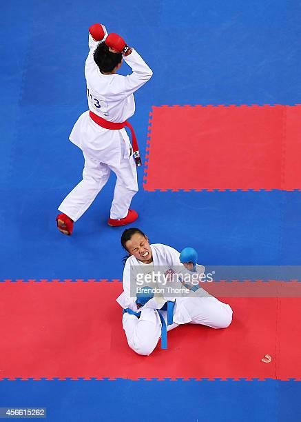 Tsui Ping Ku of Chinese Taipei celebrates victory as Yee Ting Tsang of Hong Kong shows her dejection following the Women's -50kg Semi Final during...
