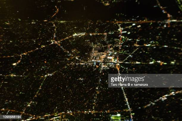 JR Tsujido station in Fujisawa city in Kanagawa prefecture in Japan night time aerial view from airplane