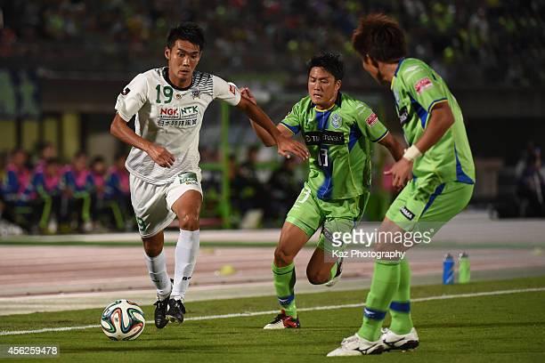 Tsukasa Masuyama of FC Gifu beats Ken Iwao of Shonan Bellmare during the J League second division match between FC Gifu and Shonan Bellmare at BMW...