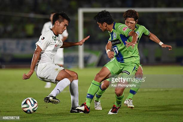 Tsukasa Masuyama of FC Gifu keeps the ball under the pressure from Ken Iwao of Shonan Bellmare during the J League second division match between FC...