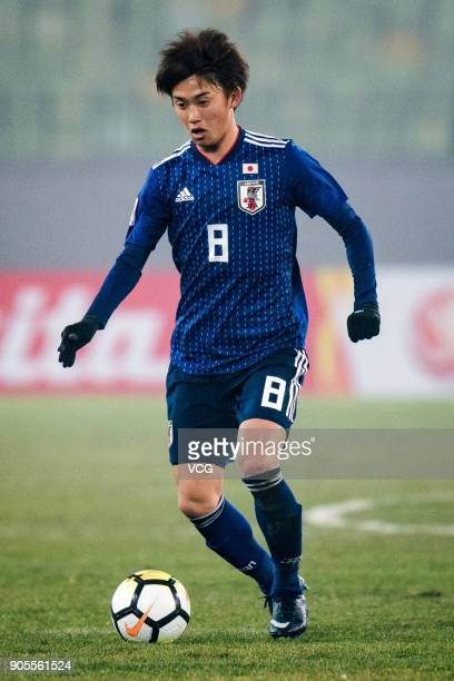 Tsukasa Morishima of Japan drives the ball during the AFC U23 Championship Group B match between Japan and North Korea at Jiangyin Stadium on January...