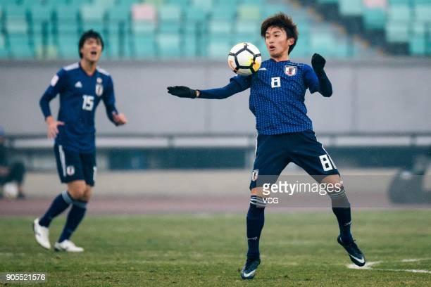 Tsukasa Morishima of Japan stops the ball during the AFC U-23 Championship Group B match between Japan and North Korea at Jiangyin Stadium on January...