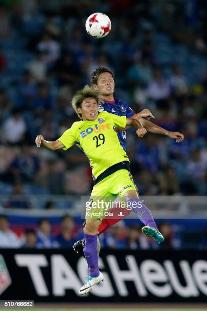 Tsukasa Morishima of Sanfrecce Hiroshima and Takashi Kanai of Yokohama F.Marinos compete for the ball during the J.League J1 match between Yokohama...