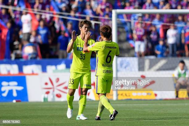 Tsukasa Shiotani and Toshihiro Aoyama of Sanfrecce Hiroshima celebrate their 21 victory after the JLeague J1 match between Ventforet Kofu and...