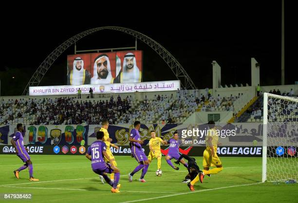Tsukasa Shiotani of Al Ain and Ronaldo Mendes of Al Wasl in action during the Arabian Gulf League match between Al Ain and Al Wasl at Khalifa bin...