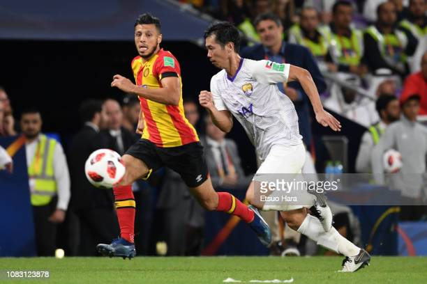 Tsukasa Shiotani of Al Ain FC and Anice Badri of ES Tunis compete for the ball during the match between ES Tunis and Al Ain FC on December 15 2018 in...