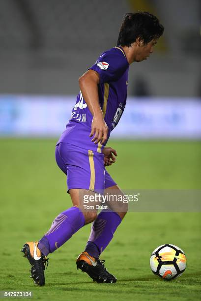 Tsukasa Shiotani of Al Ain in action during the Arabian Gulf League match between Al Ain and Al Wasl at Khalifa bin Zayed Stadium on September 16...