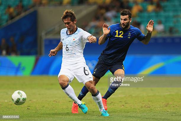 Tsukasa Shiotani of Japan and Mikael Ishak of Sweden compete for the ball during the Men's Football Group B match between Japan and Sweden at Arena...