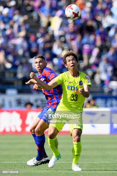 Tsukasa Shiotani of Sanfrecce Hiroshima and Dudu of Ventforet Kofu compete for the ball during the JLeague J1 match between Ventforet Kofu and...