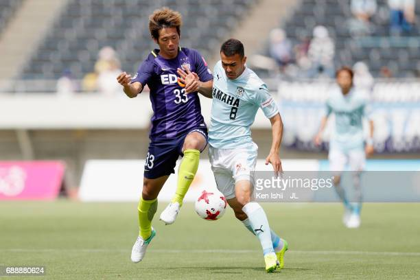 Tsukasa Shiotani of Sanfrecce Hiroshima and Fozil Musaev of Jubilo Iwata compete for the ball during the JLeague J1 match between Sanfrecce Hiroshima...