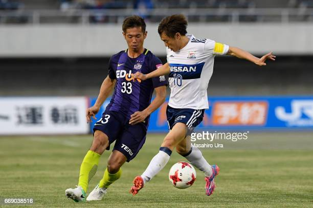 Tsukasa Shiotani of Sanfrecce Hiroshima and Manabu Saito of Yokohama FMarinos compete for the ball during the JLeague J1 match between Sanfrecce...