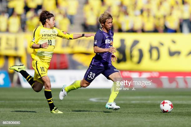 Tsukasa Shiotani of Sanfrecce Hiroshima and Yuki Otsu of Kashiwa Reysol compete for the ball during the JLeague J1 match between Sanfrecce Hiroshima...