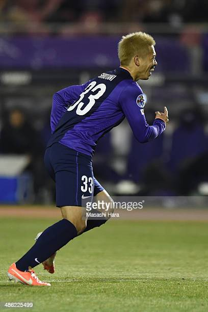 Tsukasa Shiotani of Sanfrecce Hiroshima celebrates after his assist of the first goal during the AFC Champions League Group F match between Sanfrecce...