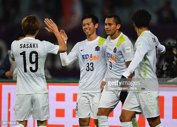 Tsukasa Shiotani of Sanfrecce Hiroshima celebrates with teammates after scoring during the the FIFA Club World Cup Quarter Final match between TP...