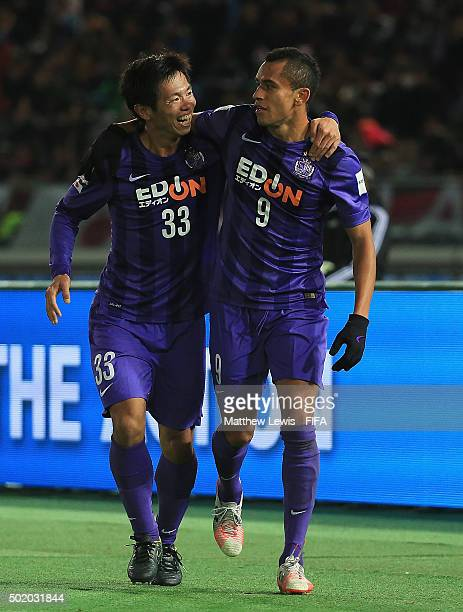 Tsukasa Shiotani of Sanfrecce Hiroshima congratulates Douglas on his second goal during the FIFA Club World Cup 3rd Place Match match between...
