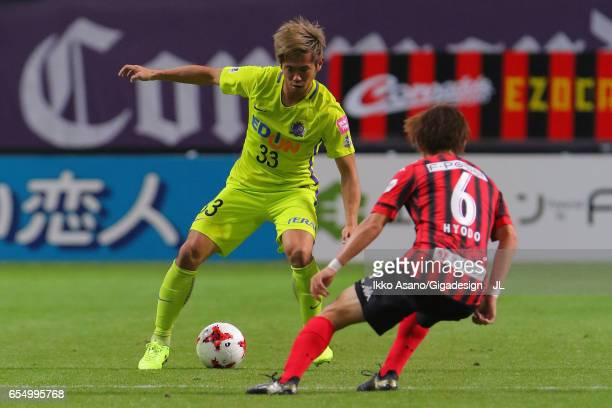 Tsukasa Shiotani of Sanfrecce Hiroshima takes on Shingo Hyodo of Consadole Sapporo during the JLeague J1 match between Consadole Sapporo and...