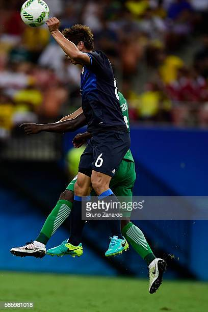 Tsukasa Shiotani player of Japan battles for the ball with Oghenekaro Etebo player of Nigeria during 2016 Summer Olympics match between Japan and...