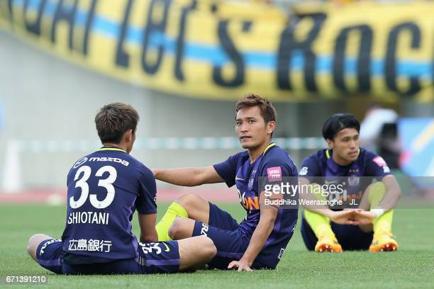 Tsukasa Shiotani Toshihiro Aoyama and Masato Kudo of Sanfrecce Hiroshima show dejection after the 33 draw in the JLeague J1 match between Sanfrecce...