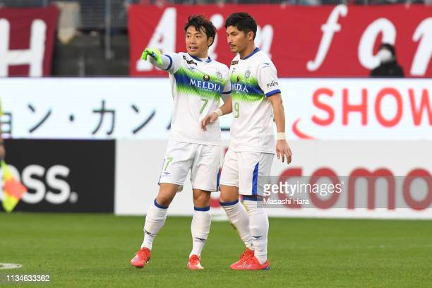 Tsukasa Umesaki and Kosuke Taketomi of Shonan Bellmare look on during the JLeague J1 match between Kashima Antlers and Shonan Bellmare at Kashima...