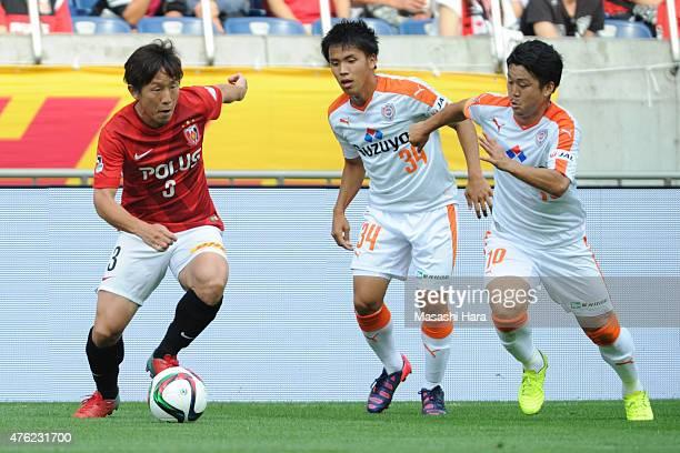 Tsukasa Umesaki of Urawa Red Diamonds in action during the J.League match between Urawa Red Diamonds and Shimizu S-Pulse at Saitama Stadium on June...