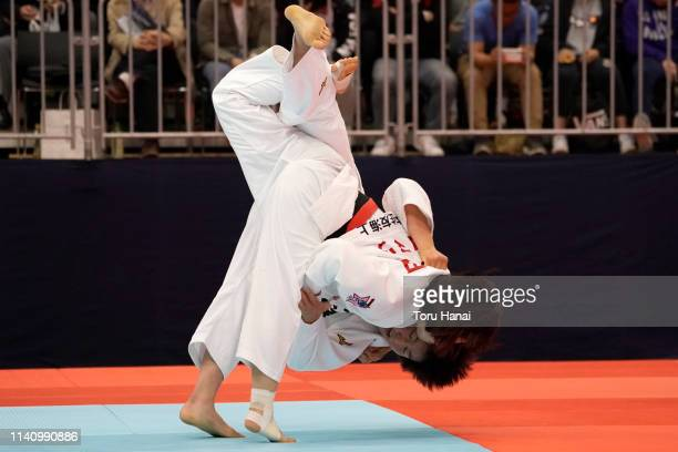Tsukasa Yoshida and Kana Tomizawa compete in the Women's 57kg semi final match during day two of the All Japan Judo Championships By Weight Category...