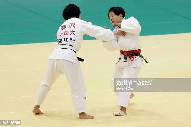 Tsukasa Yoshida competes against Kana Tomizawa in the Women's 57kg match on day two of the All Japan Judo Championships by Weight Category at Fukuoka...
