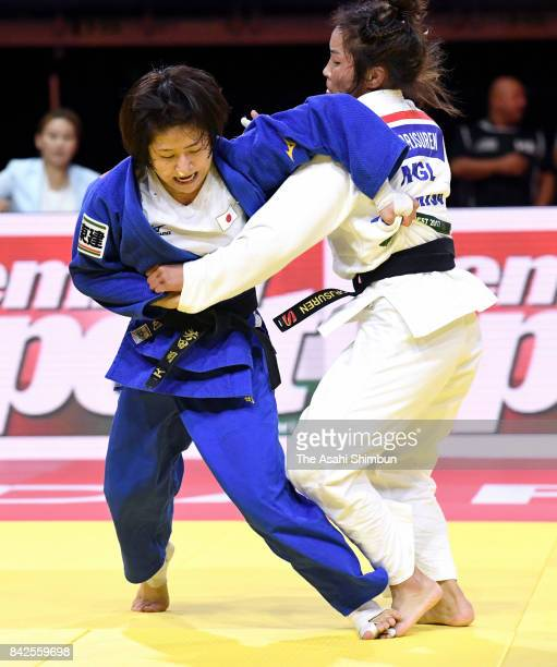Tsukasa Yoshida of Japan and Dorjsurengiin Sumiyaa of Mongolia compete in the Women's 57kg final during day three of the World Judo Championships at...