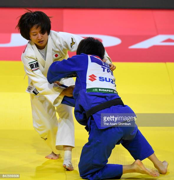 Tsukasa Yoshida of Japan and Lien Chenling of Chinese Taipei compete in the Women's 57kg quarter final during day three of the World Judo...